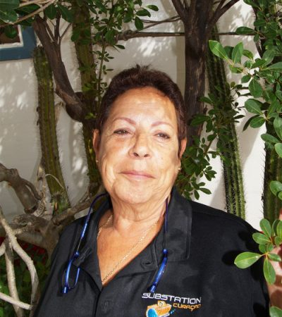 Laureen Schenk visitors coordinator, certified mediator, diving instructor at substation Curaçao is smiling into the camera.